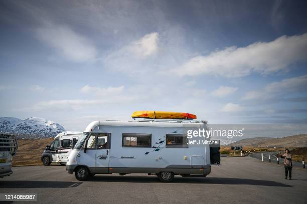 Camper vans are parked up in Glen Coe as members of the public are asked to stop traveling to the Scottish Highlands in a bid to avoid spreading the...