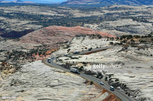 Campers and cars make their way down sandstone cliffs on Highway 12 near Hells Backbone and Calf Creek area of the Grand StaircaseEscalante National...