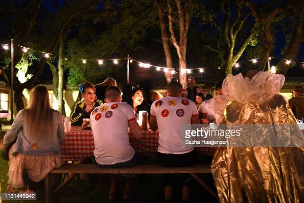 Campers eat a barbeque dinner before the Talent Show at Camp TAZO on March 15 2019 in Marble Falls Texas