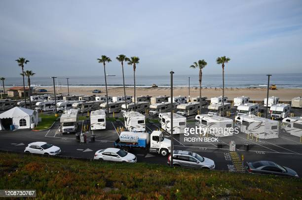 Campers in a beachside parking lot being used as an isolation zone for people with COVID-19, on March 31 at Dockweiler State Beach in Los Angeles,...
