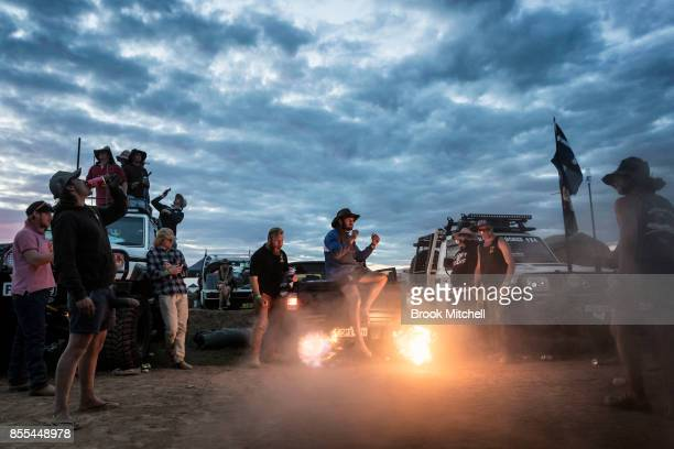 Campers in the 'Ute Paddock' play up around a Ute spitting fire from it's exhaust at the 2017 Deni Ute Muster on September 29 2017 in Deniliquin...