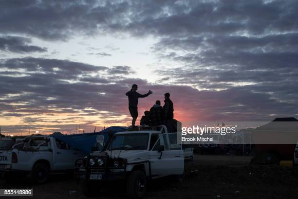Campers in the 'Ute Paddock' watch the sun go down at the 2017 Deni Ute Muster on September 29 2017 in Deniliquin Australia The annual Deniliquin Ute...
