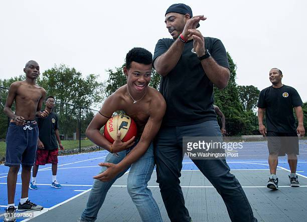 Campers Jaylan Miles Robert Brent Jr and MosesElijah Easley play basketball with firefighters Joey Brooks and James Montgomery at International Burn...