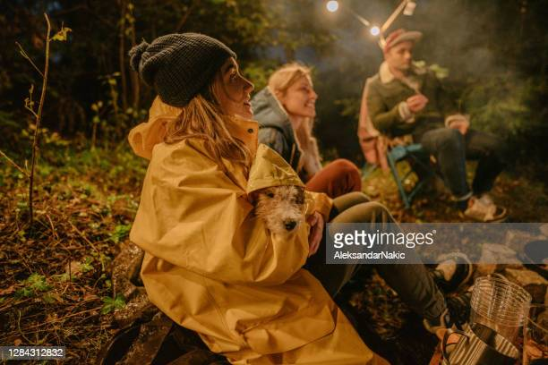 campers - warming up stock pictures, royalty-free photos & images