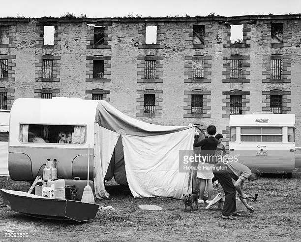 Campers set up their tent outside the old penitentiary in Port Arthur a former convict settlement in Tasmania circa 1955