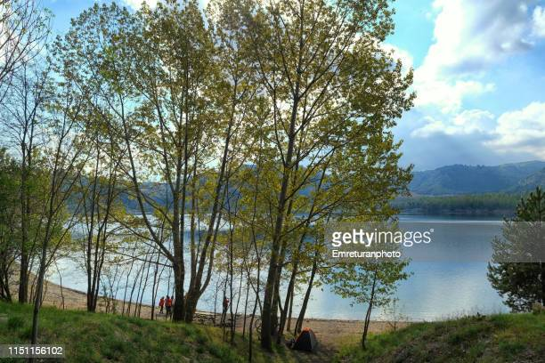 campers standing at gölcük lake shore near isparta. - emreturanphoto stock pictures, royalty-free photos & images