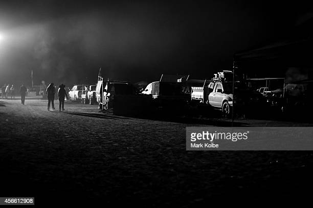 Campers walk in the 'Ute Paddock' on the first day of the 2014 Deni Ute Muster at the Play on the Plains Festival grounds on October 3 2014 in...