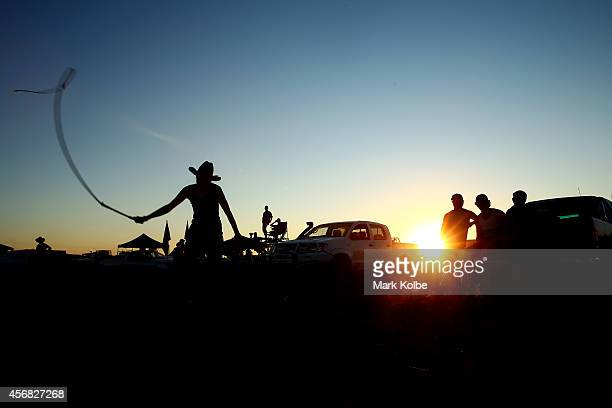 Campers watch on in the late afternoon as a whip is cracked in the 'Ute Paddock' camp ground on the first day of the 2014 Deni Ute Muster at the Play...