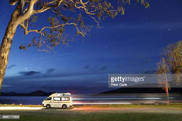 campervan at dusk , lights, mountains
