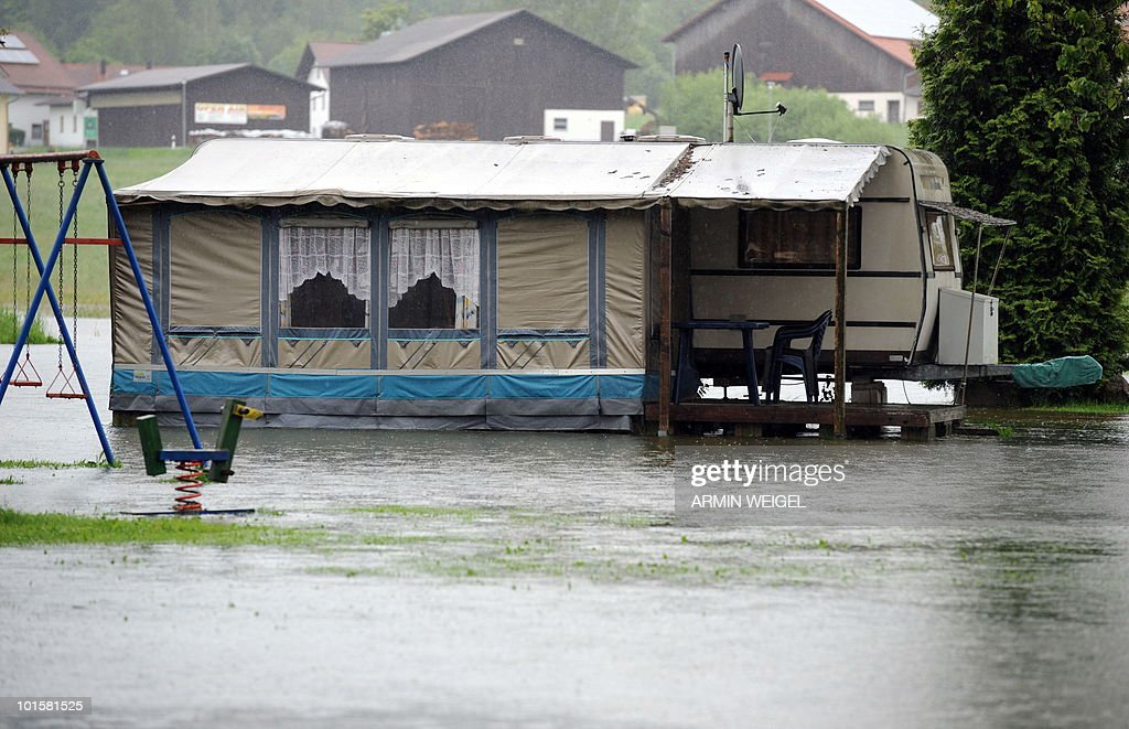 A campervan stands on a flooded camping site in Bad Koetzting, southeastern Germany on June 3, 2010. Many rivers and streets are flooded in southern Germany due to heavy rainfalls during the last days.