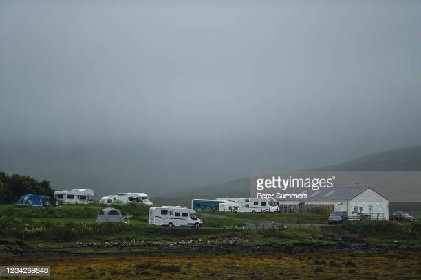 Campervans are seen at a campsite on July 27, 2021 in Dunvegan, Scotland. Skye and Raasay attracted 650,000 visitors in pre-covid 2019 with a...