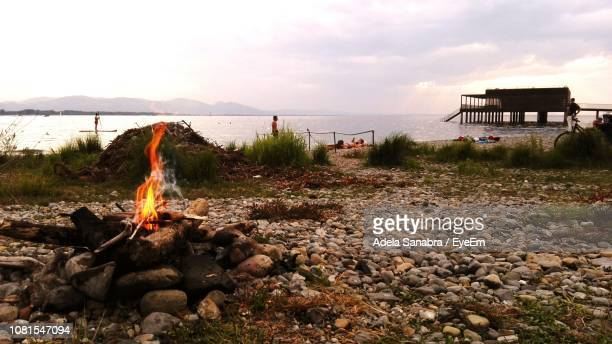 Campfire At Beach Against Sky During Sunset