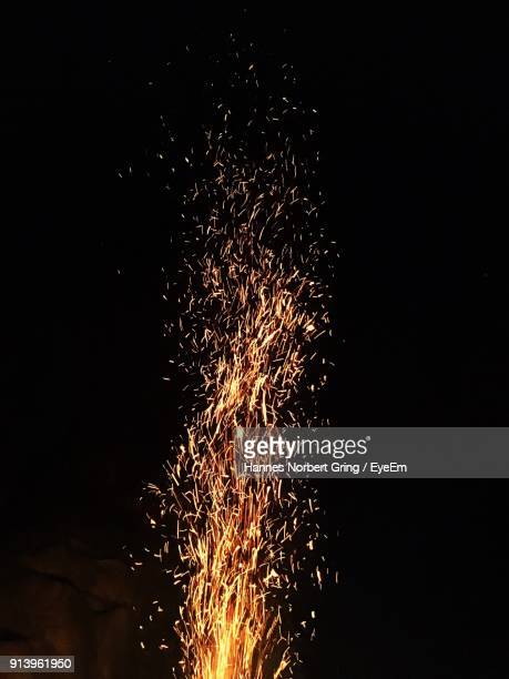 campfire burning against sky at night - sparks stock pictures, royalty-free photos & images
