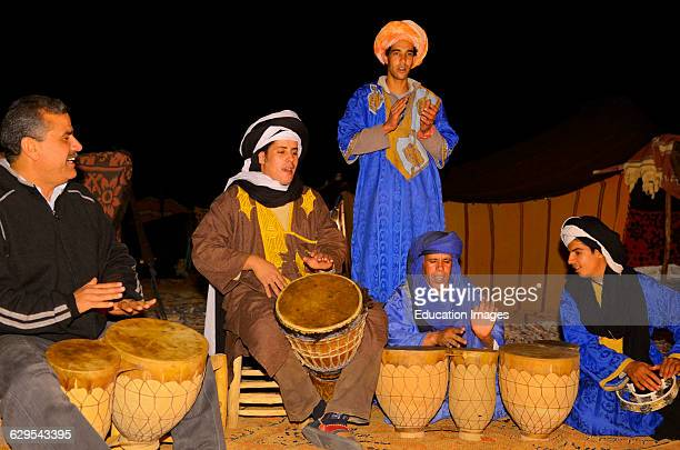 Campfire drumming circle at Berber tent camp in the Erg Chebbi desert Morocco