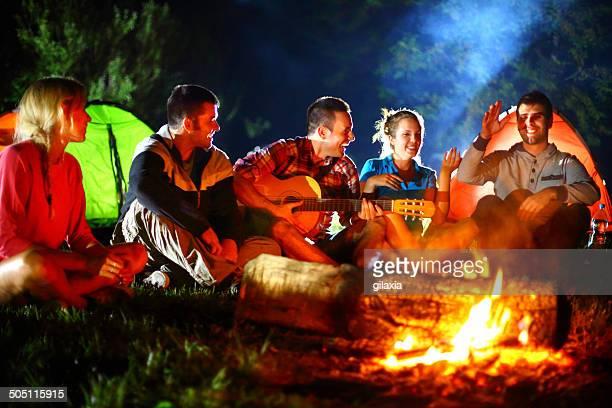 Campfire guitar session.