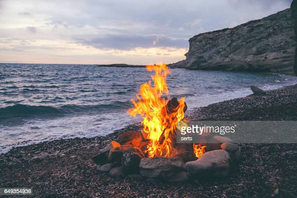 campfire on the beach - campfire stock pictures, royalty-free photos & images