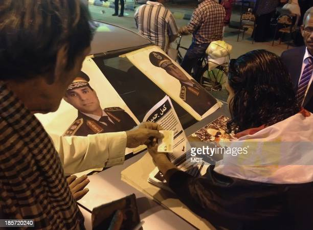 A campign workers collects signatures in Egypt's Monofyaa governorate calling for Gen Abdel Fatah el Sissi Egypt's de facto leader to run for the...