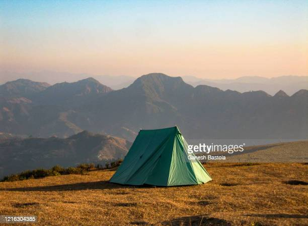 camping above the hills in the the with the aerial view. sirkot, sworek, syangja, nepal. amazing paragliding spot. - tent stock pictures, royalty-free photos & images