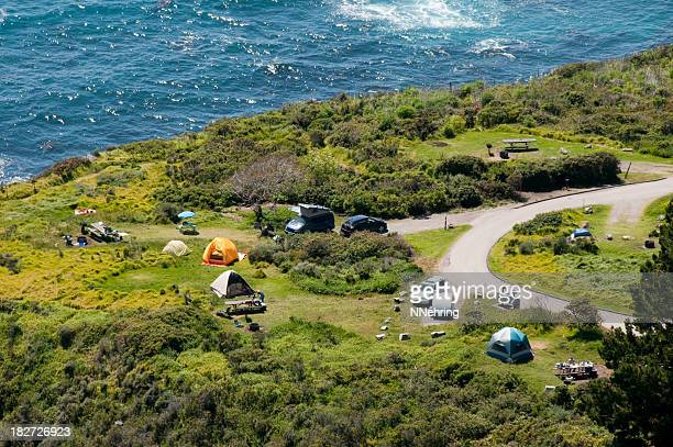 camping along ocean aerial view - big sur stock pictures, royalty-free photos & images