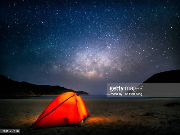 Camping at beach under milky way