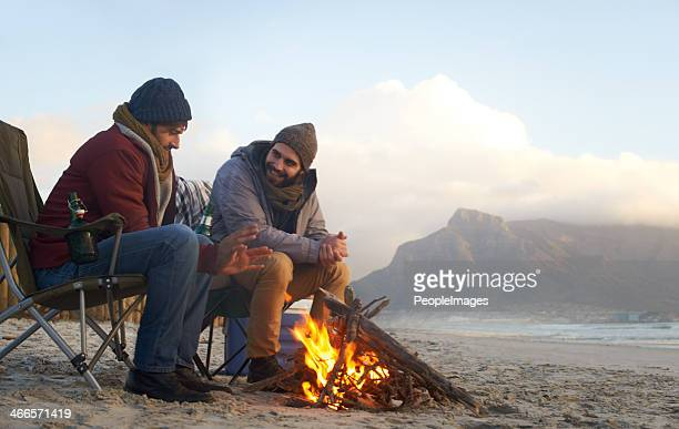 camping by the ocean - campfire stock pictures, royalty-free photos & images