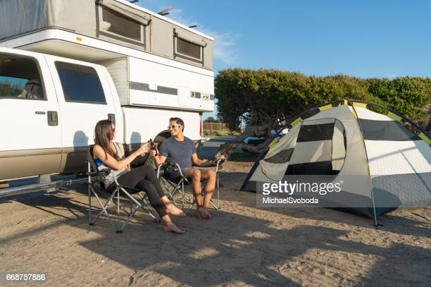 Camping Couple Relaxing in camp.