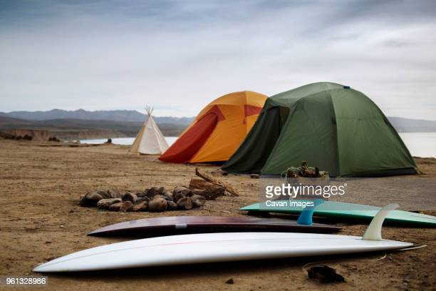 camping equipment at beach against clear sky - baja california peninsula stock pictures, royalty-free photos & images
