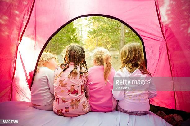 camping, girls talking in door of tent
