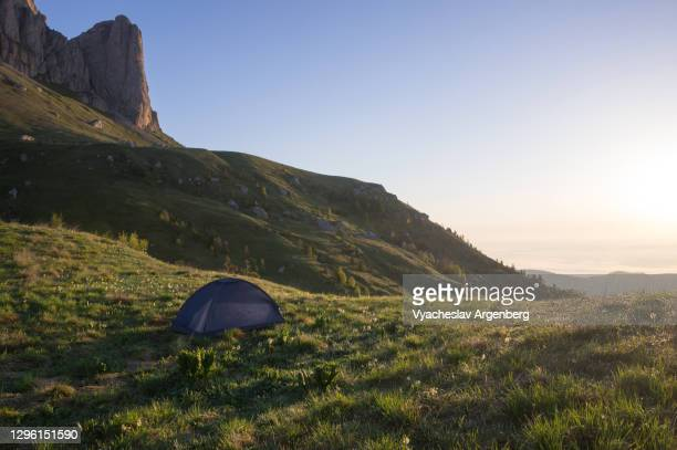 camping in the mountains, meeting sunrise at 5am very early in the morning, bolshoy tkhach, caucasus mountains - argenberg stock pictures, royalty-free photos & images