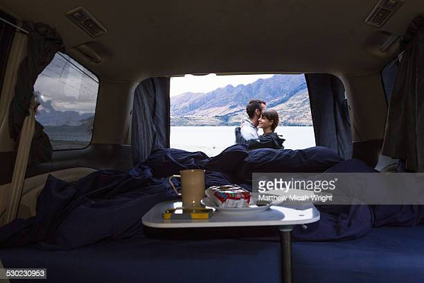 A camping meal inside a campervan.