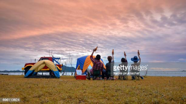 Camping  people and sunset background . Holiday , vacation , summer concept .