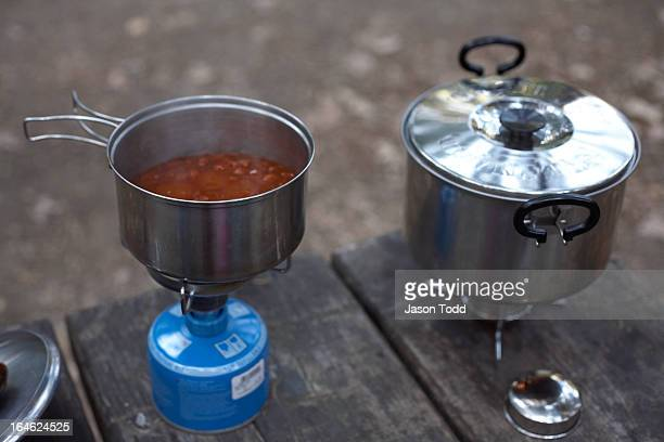 camping stove with butane burner in front of tent