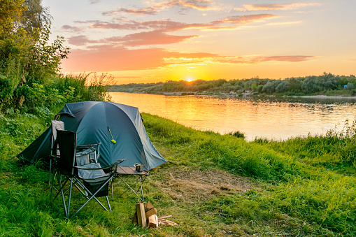 Camping tent in a camping in a forest by the river 911995140