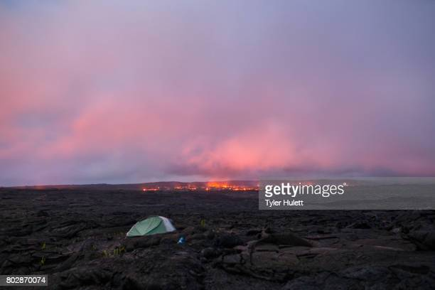 camping tent near lava flow at dusk - pu'u o'o vent stock pictures, royalty-free photos & images