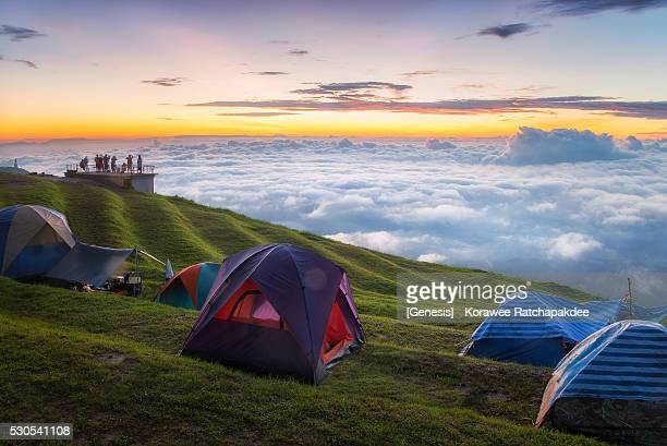 A camping tents and group of tourist in the beautiful sunrise