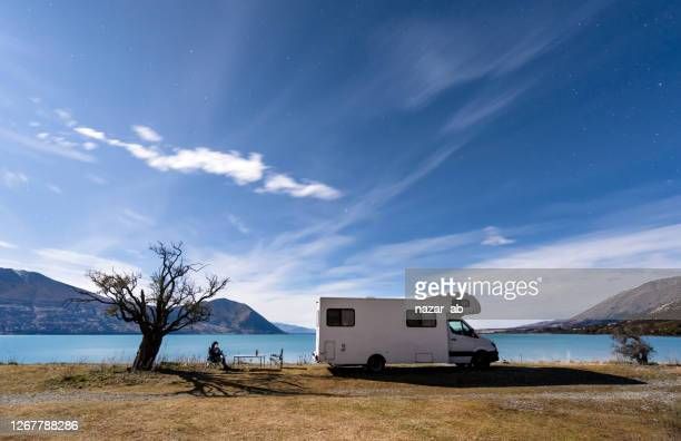 camping under stars. - camper trailer stock pictures, royalty-free photos & images
