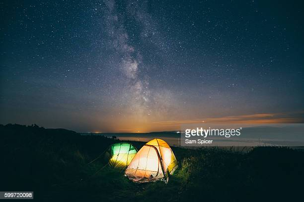 camping under the milky way - wonderlust stock photos and pictures