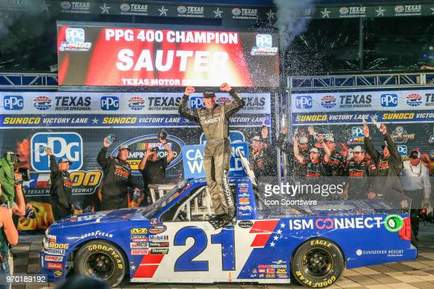 Camping World Truck Series driver Johnny Sauter celebrates in Victory Lane after winning the PPG 400 on June 8 2018 at Texas Motor Speedway in Fort...