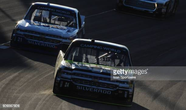 Camping World Truck Series driver Justin Haley and Johnny Sauter turn laps during practice for the Stratosphere 200 at Las Vegas Motor Speedway in...