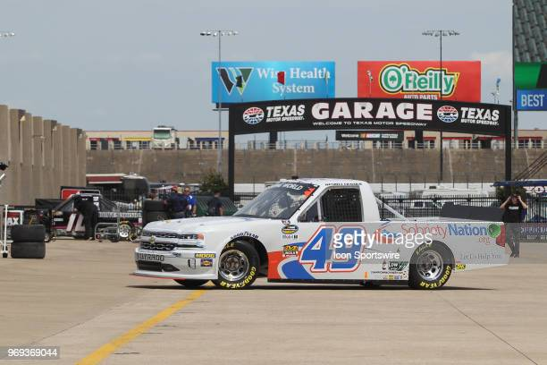 Camping World Truck Series driver Wendell Chavous backs out of his garage stall during practice for the PPG 400 on June 7 2018 at Texas Motor...