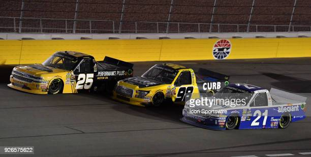 Camping World Truck Series drivers Dalton Sargeant Grant Enfinger and Johnny Sauter go three wide during the Stratosphere 200 at Las Vegas Motor...