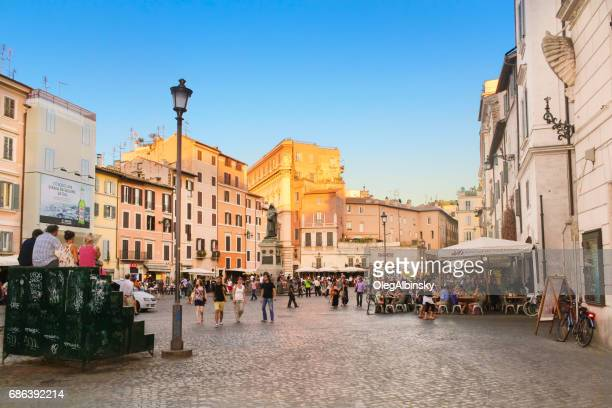 Campo de' Fiori full of Tourists and Statue of Giordano Bruno at Sunset, Rome, Italy.