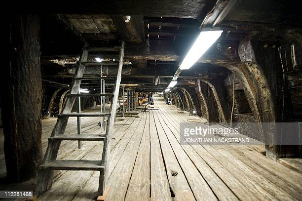CAMPREDONWorkers from the Vasa Museum inspect the ship from the inside as it is displayed in Stockholm,on April 8, 2011. Sweden's 17th century royal...