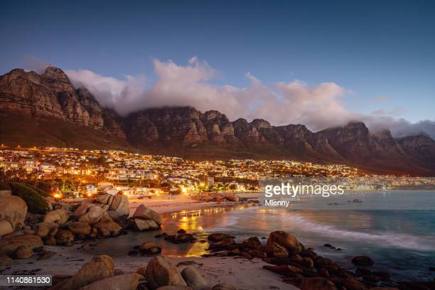 camps bay atmospheric twilight cape town south africa - cape town stock pictures, royalty-free photos & images