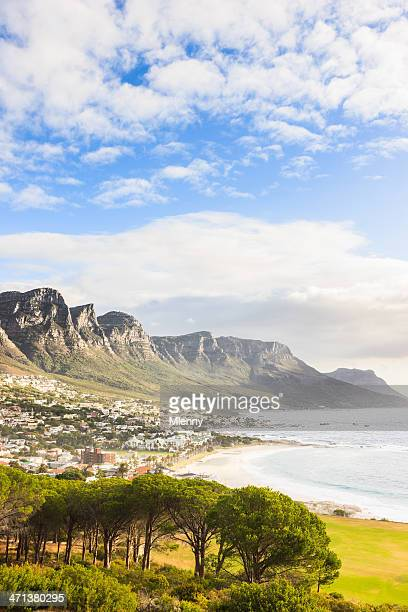 camps bay coast underneath table mountain cape town south africa - table mountain stock pictures, royalty-free photos & images