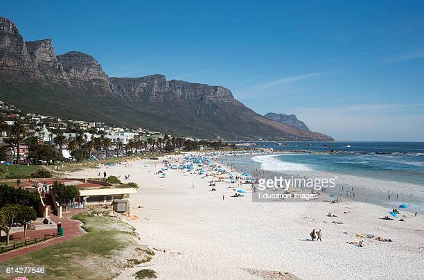 Camps Bay Resort Western Cape South Africa The Popular Sandy Beach at Camps Bay Which Is Close To Cape Town And Backed With The Twelve Apostles...