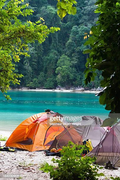 A campsite set up on the beach.