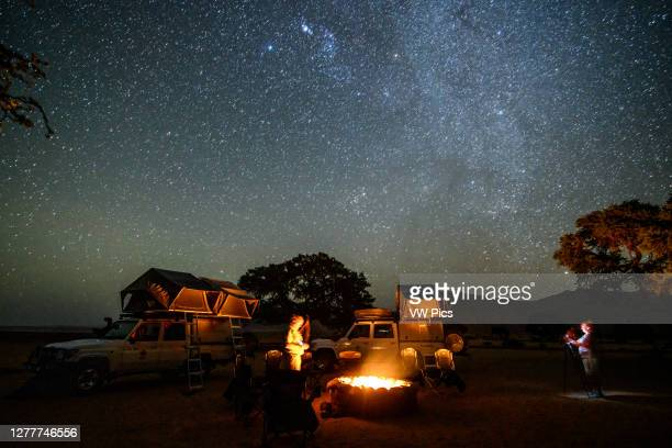 Campsite set up under the wondrous night sky , Helmeringhausen, Namibia.