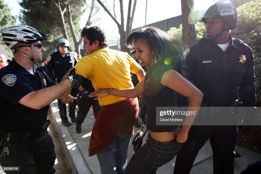 Campus police grab University of California Los Angeles (UCLA) students and supporters harassing people leaving the UC Board of Regents meeting where members voted to approve a 32 percent tuition hike next year on November 19, 2009 in Los Angeles, California. Undergraduate fees for students at the California university system would be increased by about $2,500. It is the second day that demonstrators, including students from other UC campuses, have gather to try to dissuade the board from approving the proposed increase. Massive cuts to balance the state budget have squeezed education funds in California.