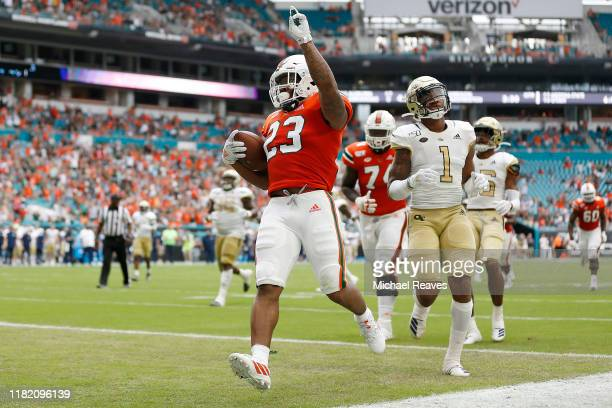 Cam'Ron Harris of the Miami Hurricanes celebrates after scoring a touchdown against the Georgia Tech Yellow Jackets during the first half at Hard...